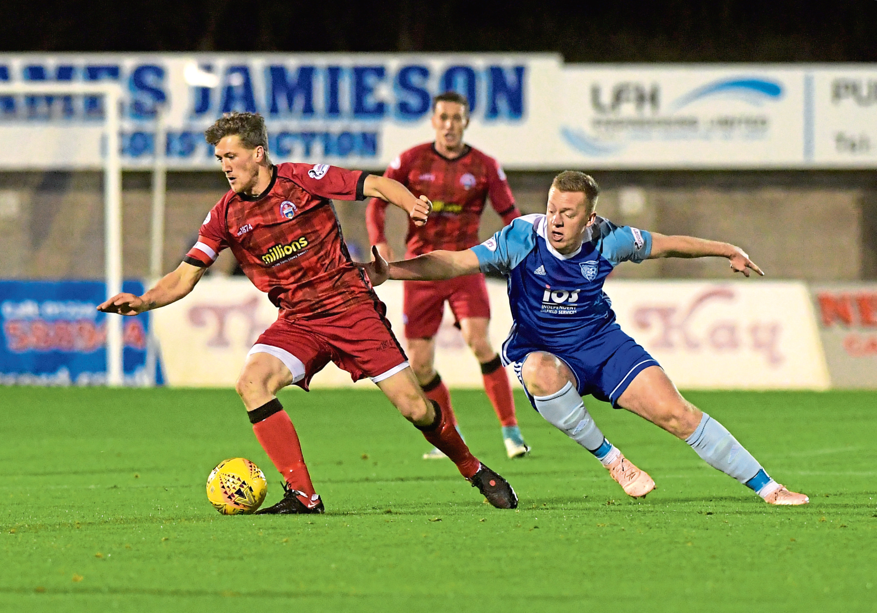 Morton's Jim McAlister and Peterhead's Scott Brown. Picture by Kath Flannery