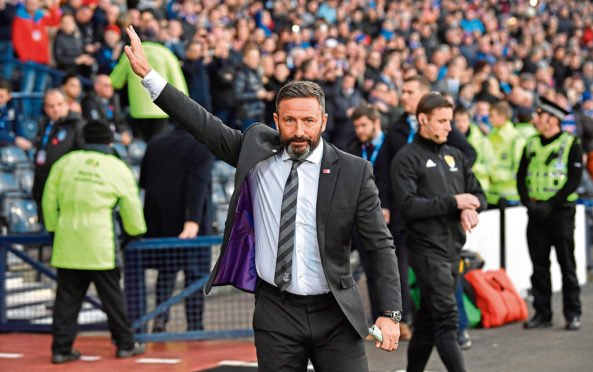 Aberdeen manager Derek McInnes waves to the fans after the Dons beat Rangers in the semi-final.