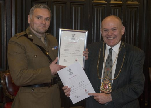 Lord Provost of Aberdeen Barney Crockett and by Lieutenant Colonel Geraint Davies, Commanding Officer of Aberdeen University Officers Training Corps