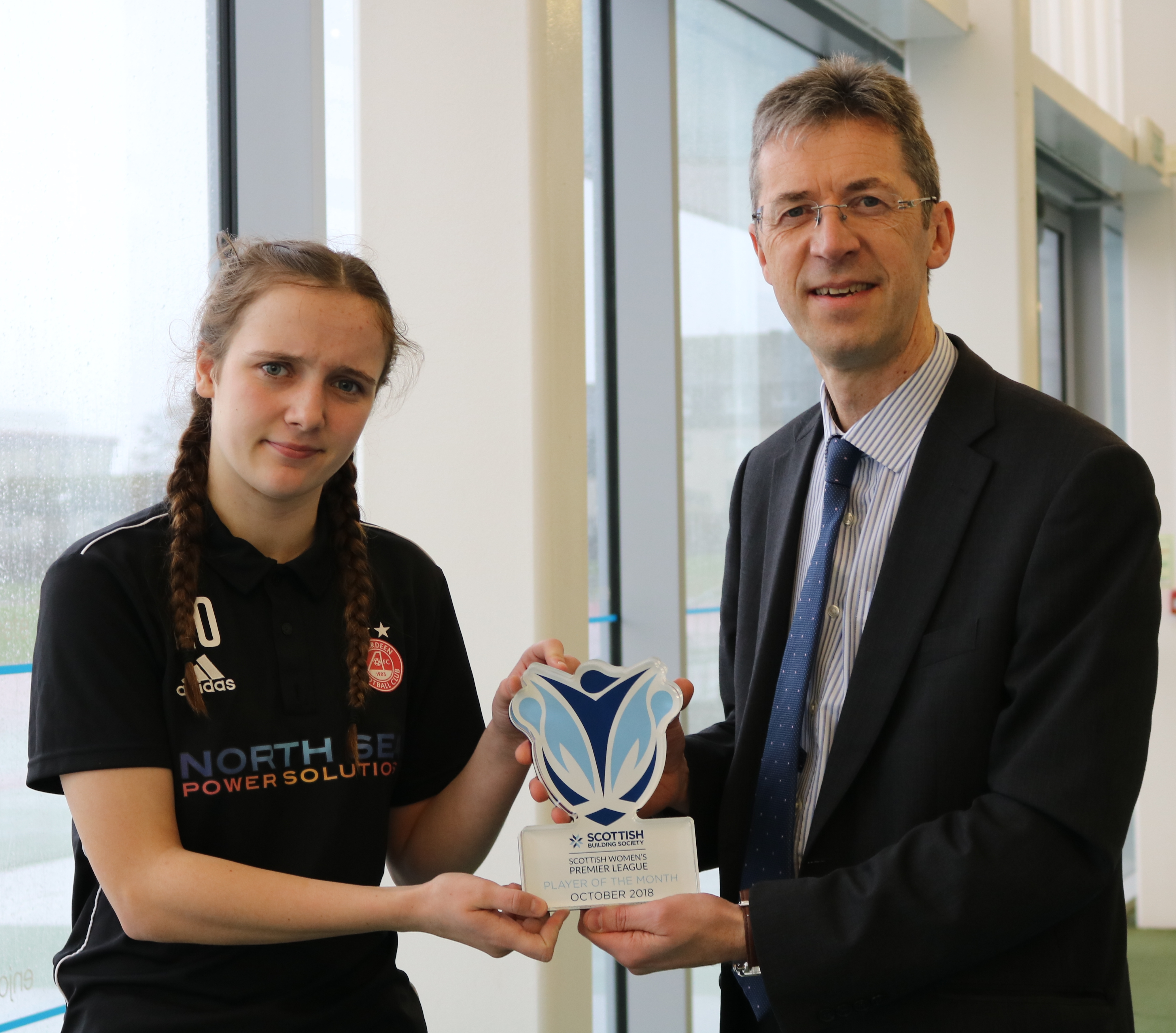 Bayley Hutchison, left, receiving her player of the month award