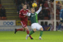 Aberdeen's Mikey Devlin, left, in action against Hibernian's Florian Kamberi.