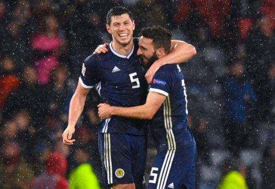Scotland's Scott McKenna, left, with team-mate Graeme Shinnie