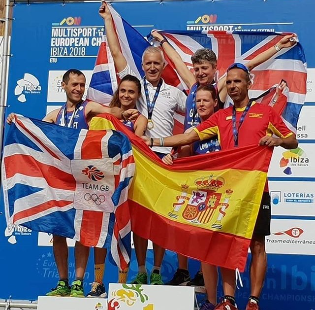 David Horne, middle in white, with his gold medal.