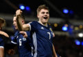 James Forrest celebrates his goal to make it 3-1 and complete his hat-trick.