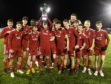 The Aberdeen players celebrate with the cup. Picture by Chris Sumner