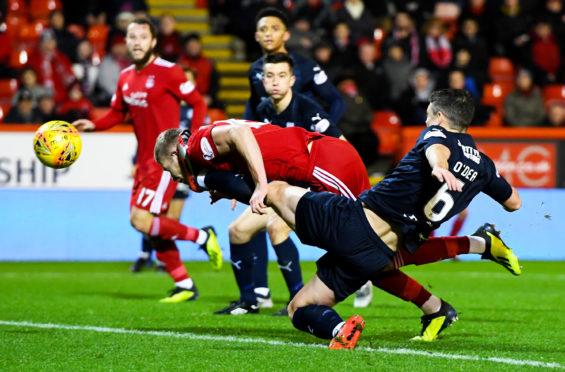 Aberdeen's Sam Cosgrove scores to make it 1-0.