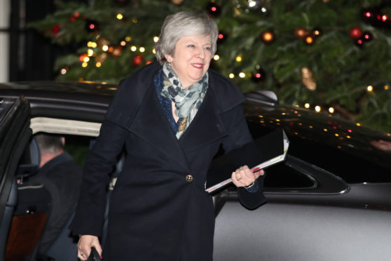 Prime Minister Theresa May arrived back at 10 Downing Street as Conservative MPs held a vote of confidence in her leadership