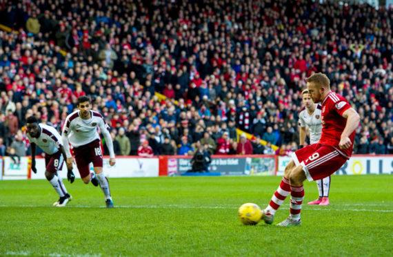 Aberdeen's Adam Rooney opens the scoring from the penalty spot.