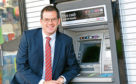 Mark McDonald at the new ATM