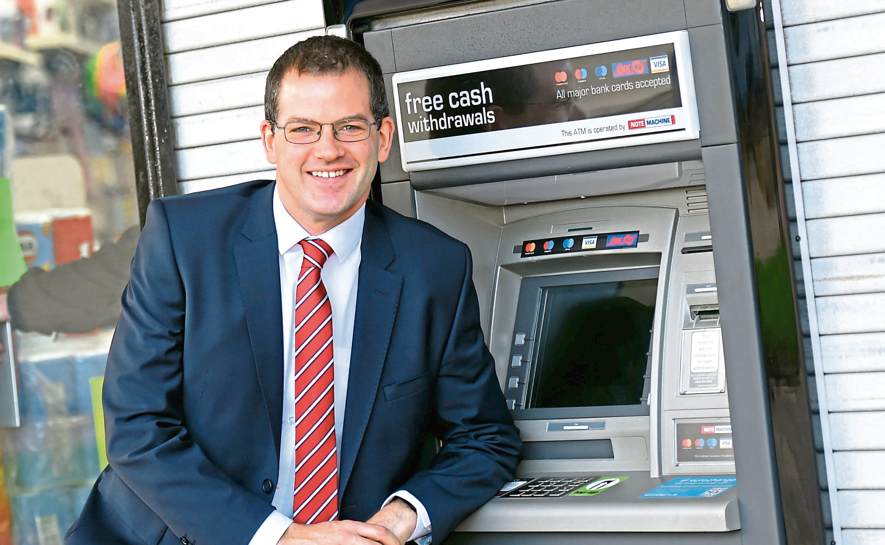 Mark McDonald at the new ATM