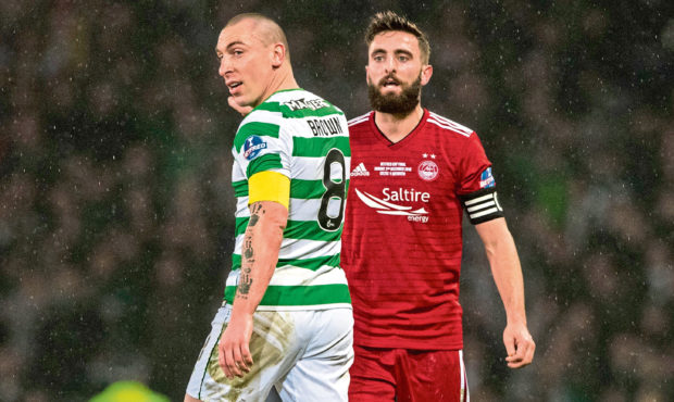 Celtic's Scott Brown with Aberdeen's Graeme Shinnie during the Betfred Cup final.