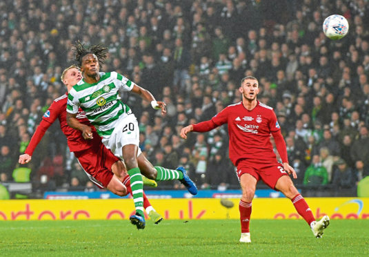 Aberdeen's Gary Mackay-Steven clashes heads with Celtic's Dedryck Boyata, with both players suffering injuries.