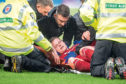 Aberdeen's Gary Mackay-Steven receives treatment after suffering a nasty head injury.
