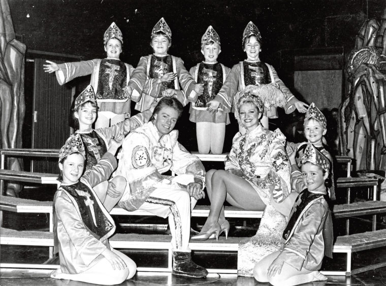 1984: Stars of Aladdin Edwina Laurie and Allan Stewart are surrounded by members of the Jessiman School of Dancing