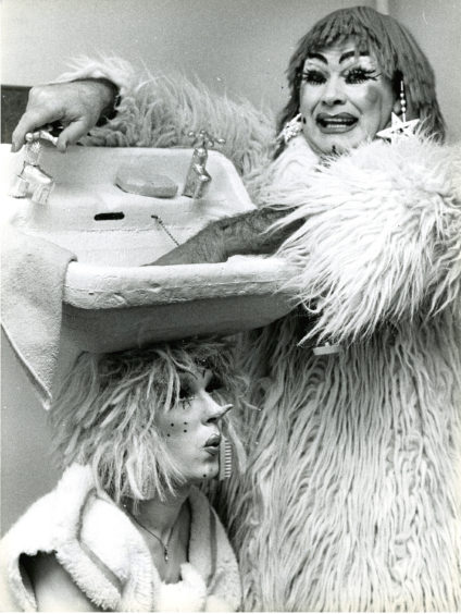 1983: The flamboyant ugly sisters' costumes even include a sink – and the pair were hoping to make a splash at HMT