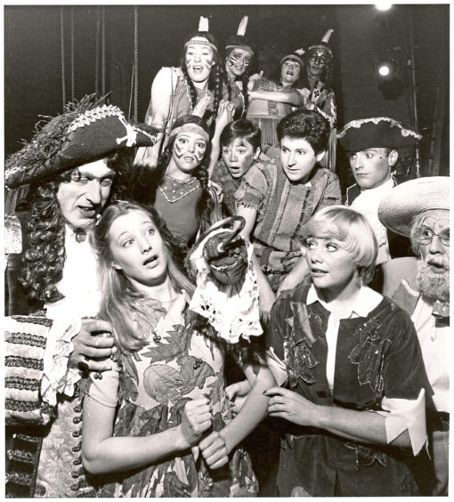 1979: Rikki Fulton as nasty old Captain Hook struggles with Wendy, played by Nikki Wright, and Anne Aston as Peter Pan