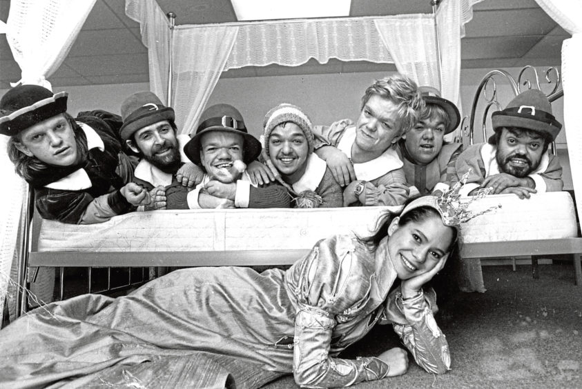 1986: There's no room in this bed for Snow White while on a tour of the Royal Workshops for the Blind in Tullos