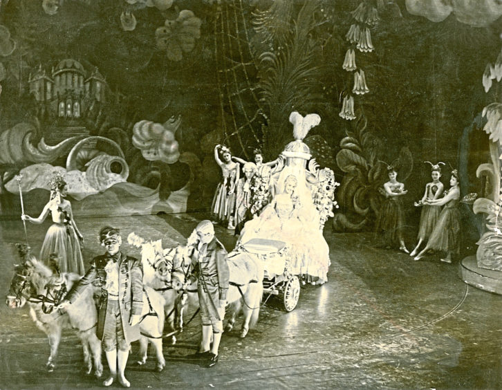 1955: Cinderella makes a dramatic arrival at the ball with her coach and horses at His Majesty's Theatre