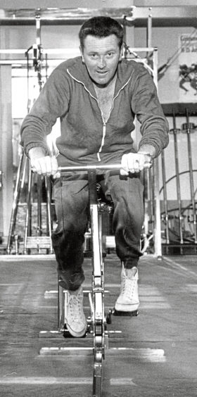 """Keep Fit 1970-04-20 Scotis Health Studios (C)AJL Used EE 22.04.1970. As middle age approaches, years of sedentary work and lack of exercise will have softened a husband up. Now is the time when he becomes most prone to the diseases which are responsible for 40% of all male deaths - coronary ailments. Brian Donald, 41 St Clair Street, has the right idea... he """"keeps fit"""" three times a week at the Scotis Health Studios in Market Street."""