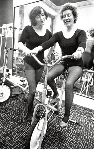 1978: Marie Murray of Hillside, Portlethen, works out on an exercise bike, under the supervision of Vi Milne, an instructor at Aberdeen Health Studio