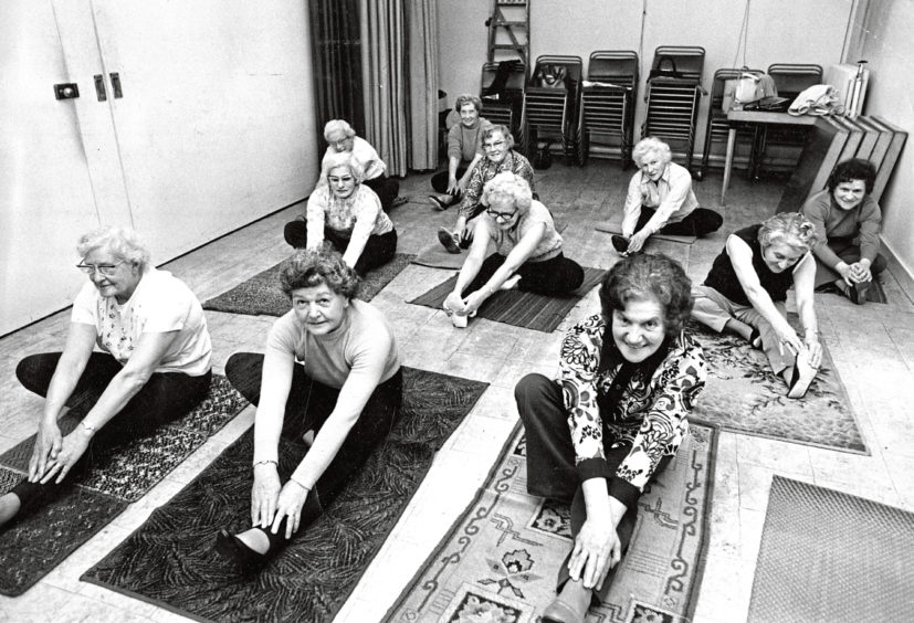 1972: An over-60s group emjoying a yoga session at Woodside Welfare Club