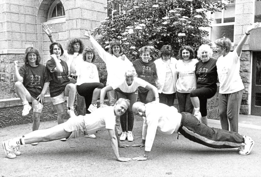1992: Gunilla Smith applies pressure to the two new male keep-fit leaders in the Scottish-Swedish Association, Jim Hunter, left, and John Boyle, watched by the new female leaders