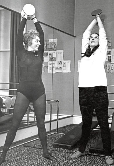 1970: Instructress Thelma Forman shows Pam Ritchie how to use a dumbbell