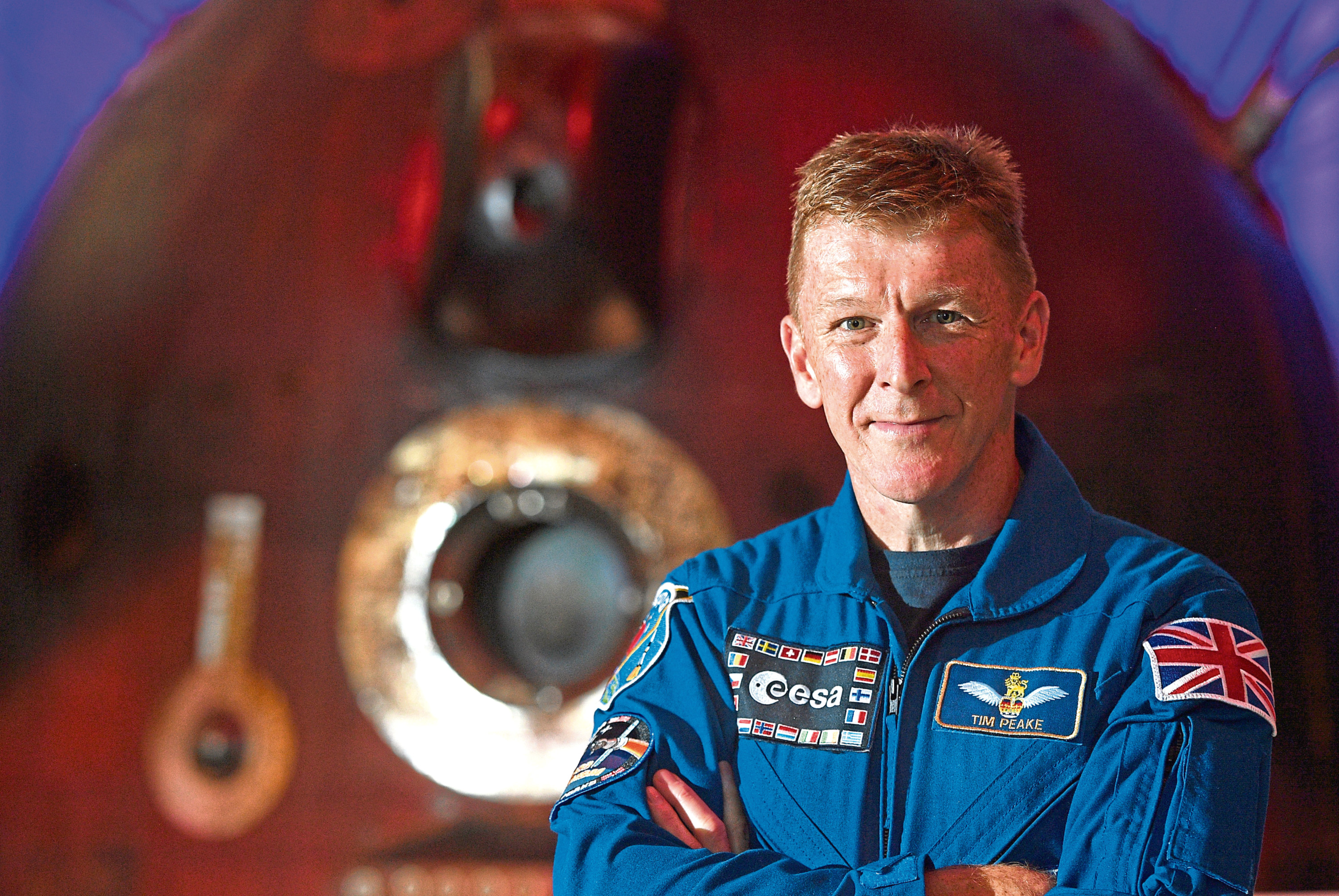 Major Tim Peake with the Soyuz descent module, the spacecraft which brought him back to Earth after his mission to the International Space Station