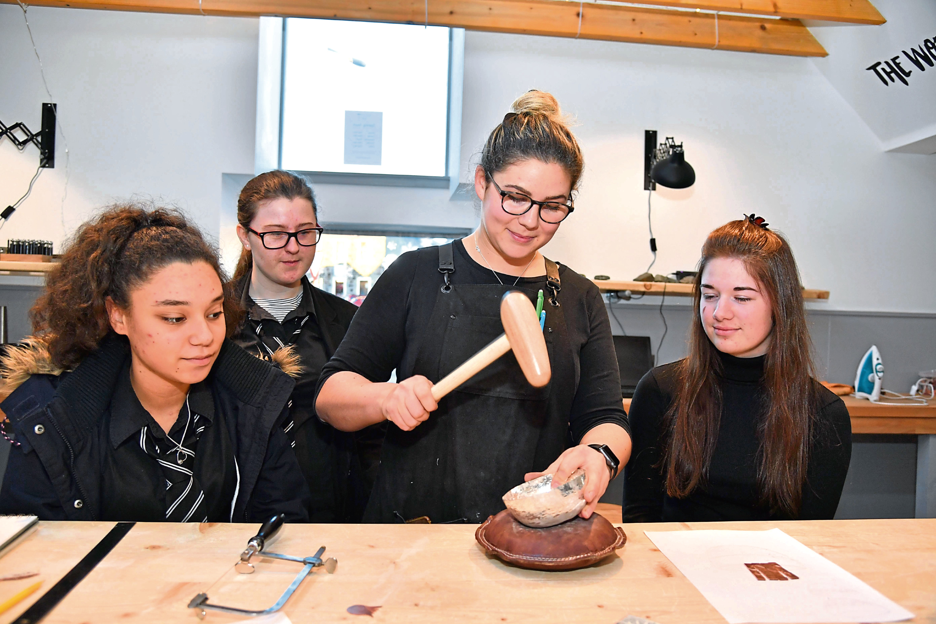 Pupils watch technician Claire Campbell at work