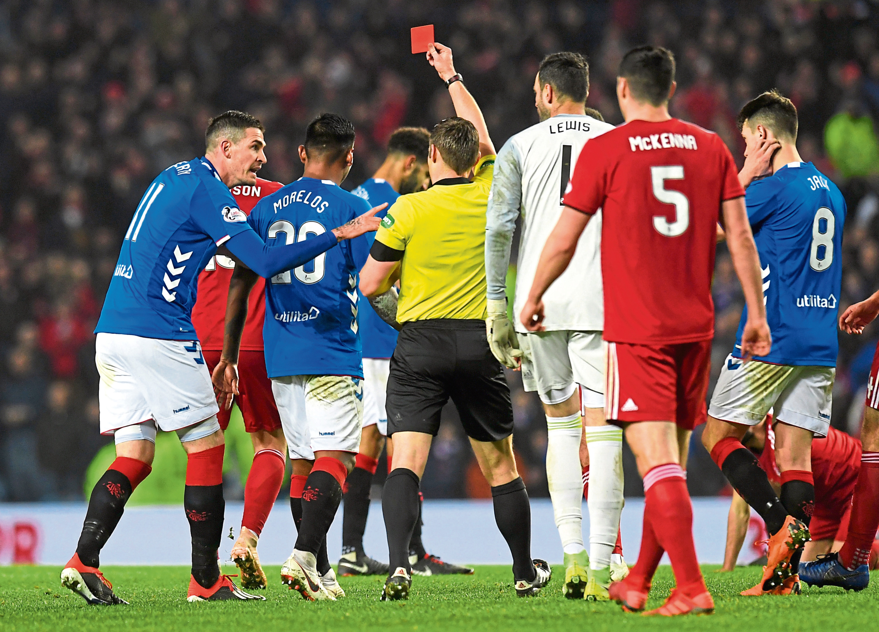 Rangers' Alfredo Morelos leaves the pitch after receiving a red card.