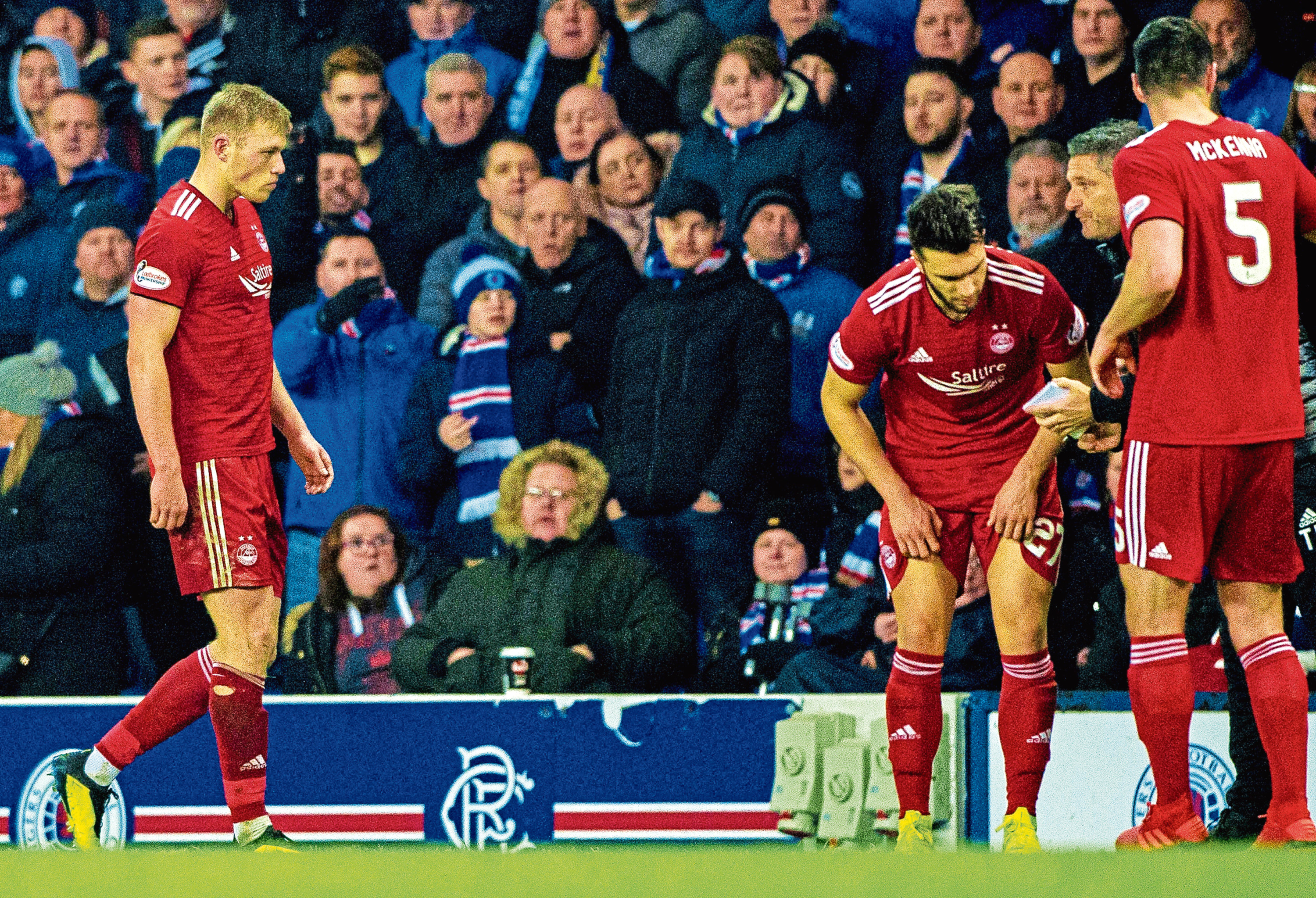 Aberdeen's Sam Cosgrove leaves the pitch after receiving a red card from referee Steven McLean at Ibrox.