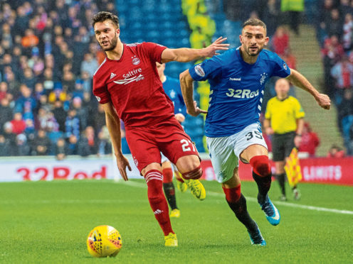 Aberdeen's Connor McLennan, left, in action against Rangers.