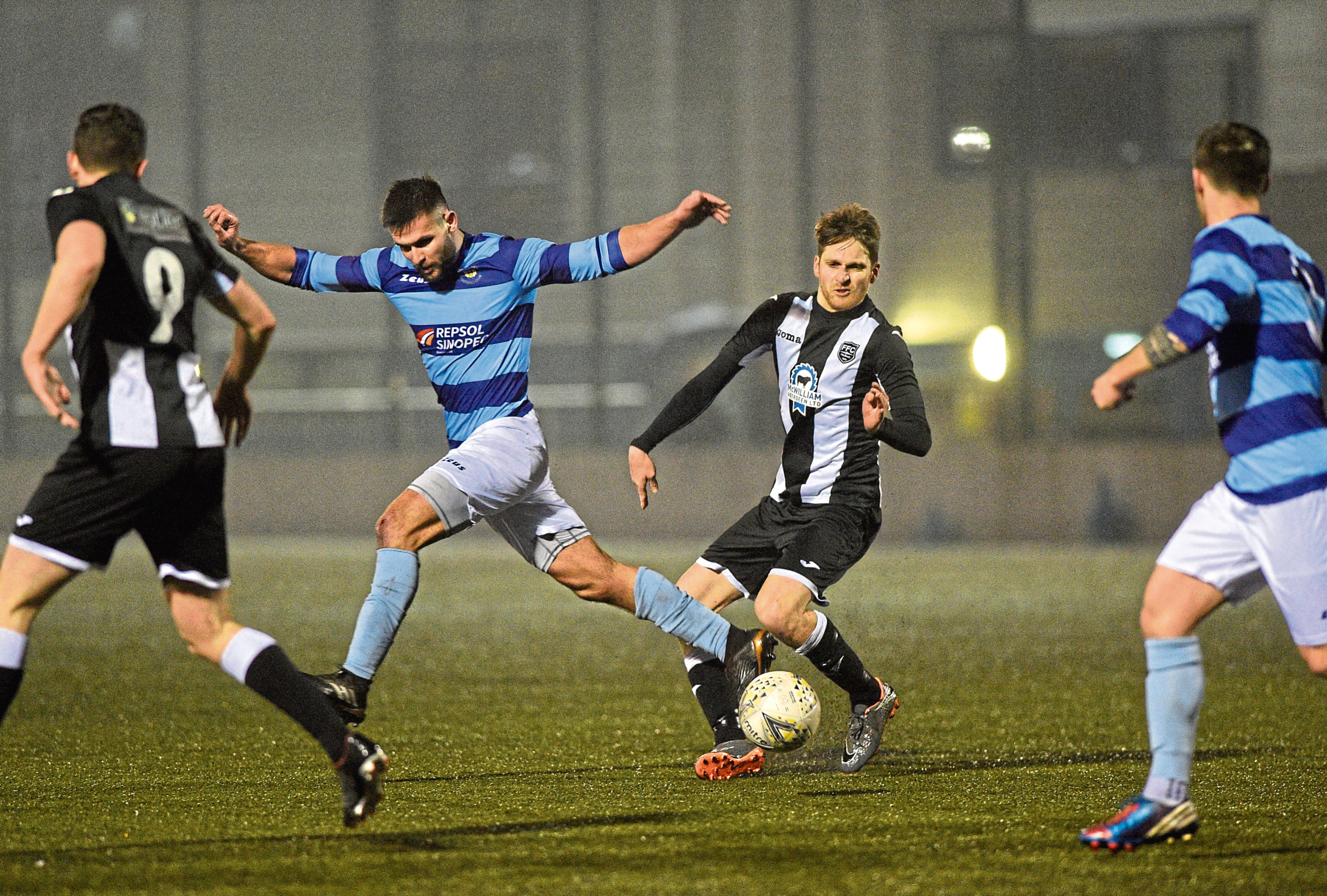 Dee's Kane Winton and Fraserburgh's Jamie Beagrie. Picture by Darrell Benns