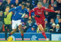 Rangers' Ovie Ejaria and Aberdeen's Dom Ball compete during the Dons win at Ibrox.