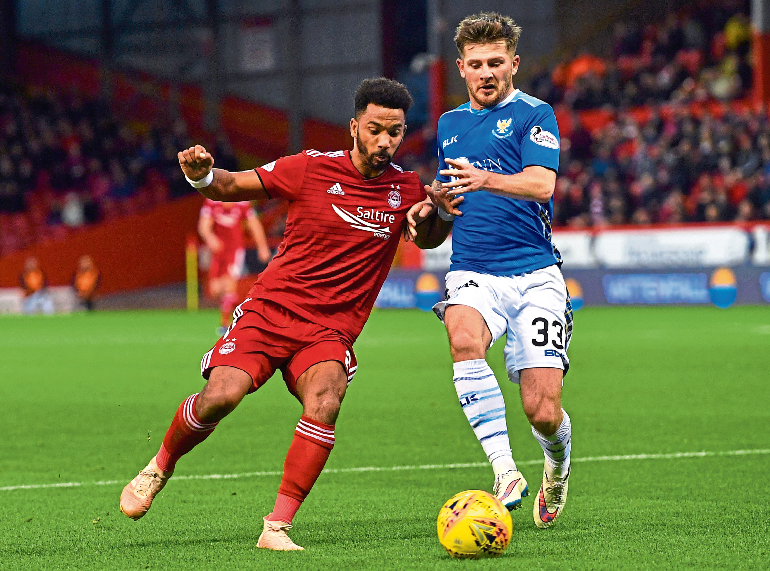 Aberdeen's Shay Logan (left) competes with St Johnstone's Matty Kennedy.