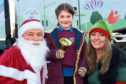 Nicol of Skene Santa and elf Stephanie Nicol, with Niamh Kavanagh, 6