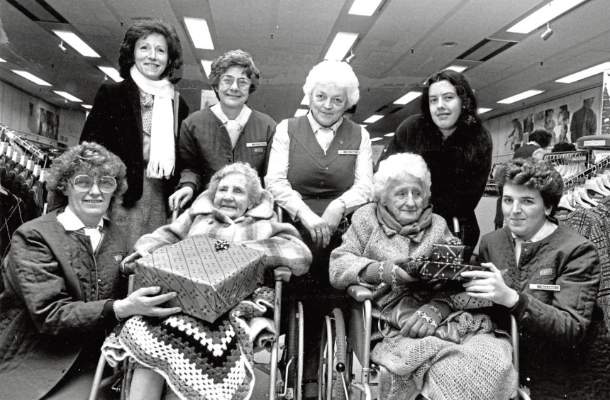 1987: Getting a helping hand from British Home Store staff are Daisy Donaldson, 88,  and Elizabeth MacKay, 73