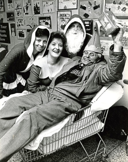 1989: Geordie Will, 84, gets a helping hand to get his shopping finished from Asda staff, from left, Karen Strachan, Alison Taylor and Eddie Murray at a special shopping event for senior citizens and disabled folk