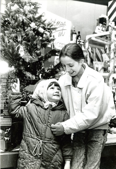 1987: Admiring a festive shop window display are Sarah Ewan, 4, and Angela Glennie, 10