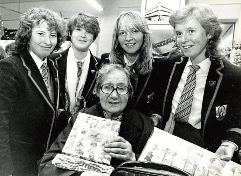 1984: Jean Slessor is helped with her shopping by Powis Academy pupils, from left, Jacqueline Booth, 15, Debbie Barclay, 16, Ruth McKenzie, 15, and Pamela McMillan, 16