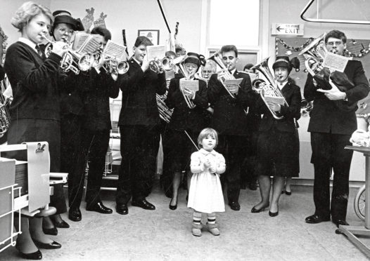 1988: Donna Stuart, 2, conducts the Aberdeen Salvation Army Band when it visited ward four of Royal Aberdeen Children's Hospital