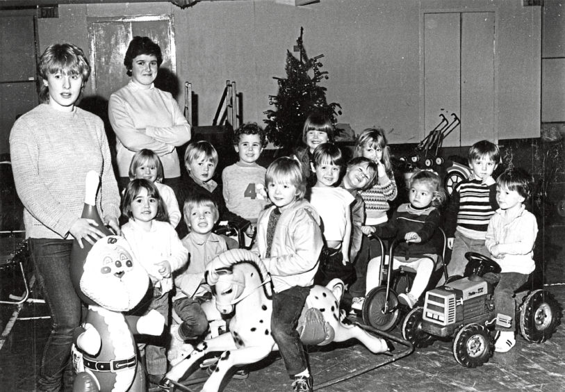 1984: Theresa Myszor, left, and Sally Morrison with the children's playgroup who meet at Aberdeen Salvation Army Citadel