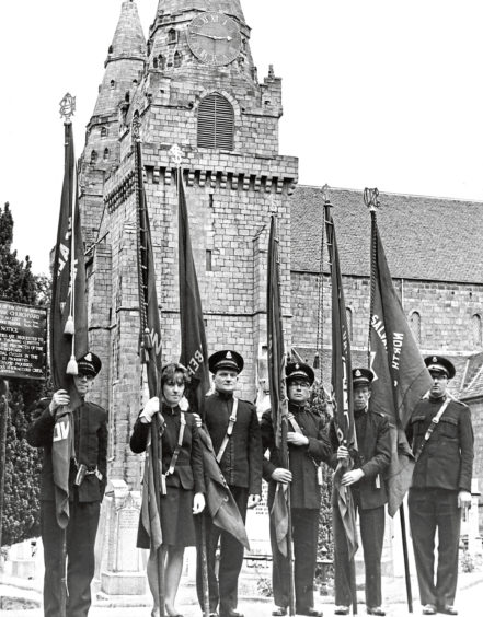 1965: The standard-bearers at the North of Scotland Salvation Army centenary thanksgiving service at St Machar's Cathedral, Aberdeen