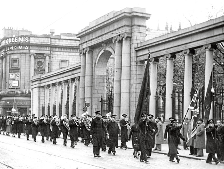 1953: A familiar sight with their uniforms, musical instruments and flags, the Salvation Army march in Aberdeen