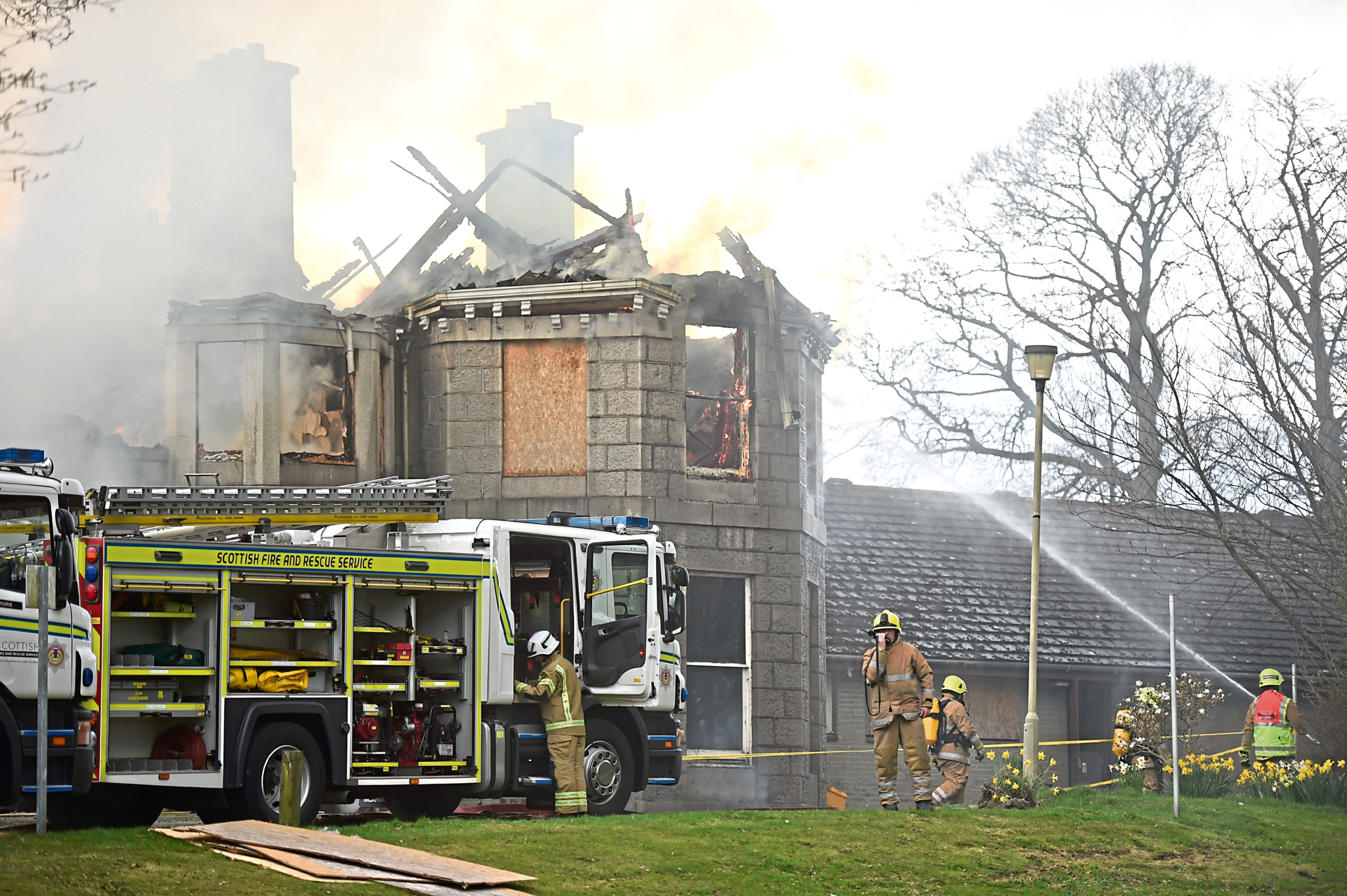 Firefighters tackling the blaze which destroyed the former Blythewood Care Home in Inverurie in April