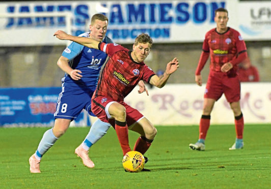 Peterhead's Scott Brown and Morton's Jim McAlister in a recent Scottish Cup game. Picture by KATH FLANNERY