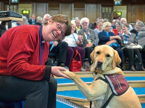 Rev Mary Whittaker and dog, Scott