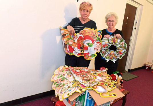Pam Lynch, left, and Helen Paterson took the decorations down.
