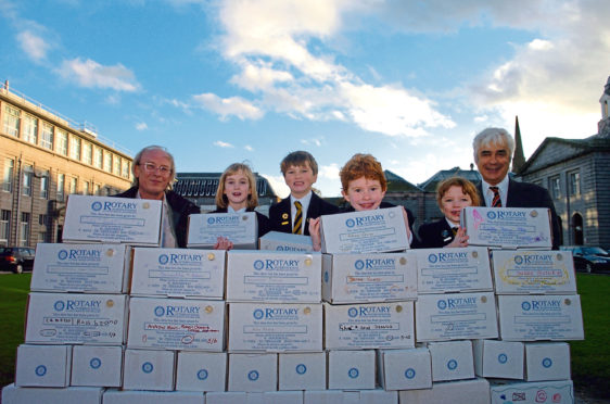 Members of Rotary clubs have been working with children from local schools to send Christmas present shoeboxes to families in poverty in Central and Eastern Europe