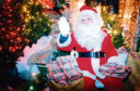 1992: Santa Claus was getting set to greet children at Findlay Clark's garden centre